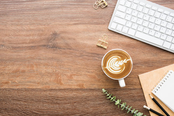 Wall Mural - Wood minimalist office desk table with computer keyboard, cup of cafe latte coffee and supplies. Top view with copy space, flat lay, minimal style.