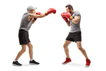 Senior man and a young man boxing