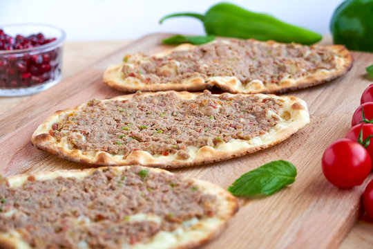 Meat with dough, manakeesh meat, arabic flat bread with meat. Close up