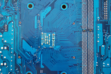 PCB of computer motherboard close-up. Electronic and computer technology. Technology of scientific knowledge, electronics repair, information recovery. Yellow background. Selective soft focus.