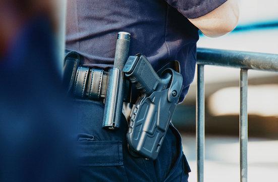 Manhattan 2019. Behind the police with gun belt