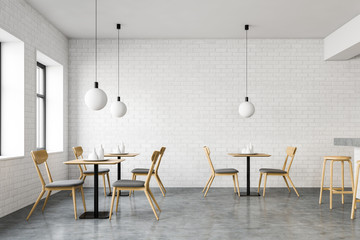 White brick loft cafe interior with tables