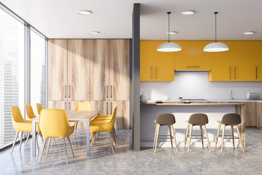 Yellow kitchen with bar and table