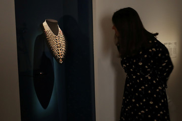 A woman looks at a necklace made with natural pearls from Arabian Gulf, on display at the Louvre Abu Dhabi Museum in Abu Dhabi