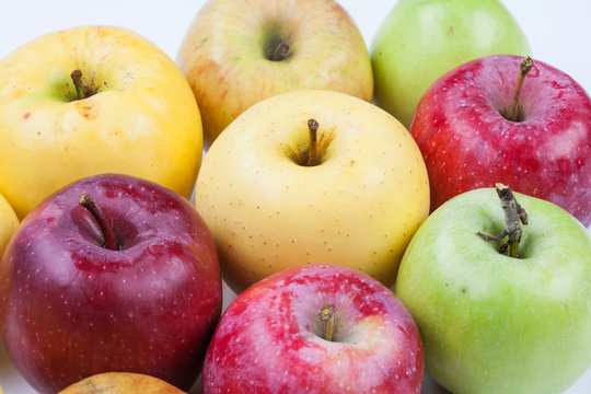 Ripe apples assortment different types. Macro view organic apple fruits red yellow green color. Macro view