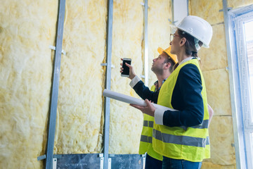 Construction manager and architect checking the insulation works