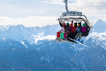 Fototapeta People on a ski funicular in the mountains. obraz