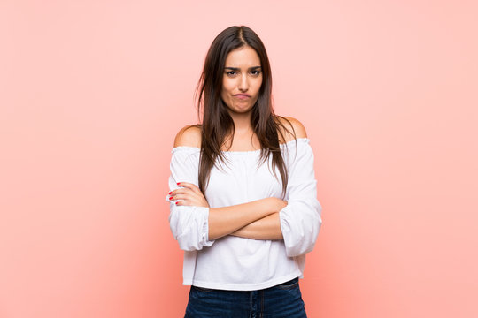 Young woman over isolated pink background feeling upset