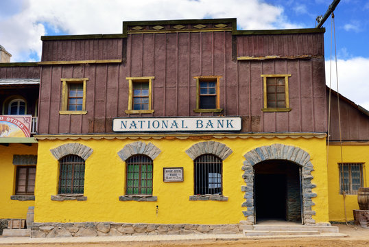 SIOUX CITY, GRAN CANARIA -  FEB 20, 2014: Street of wild west town with National Bank building in Sioux City. Popular tourist attraction in Gran Canaria island