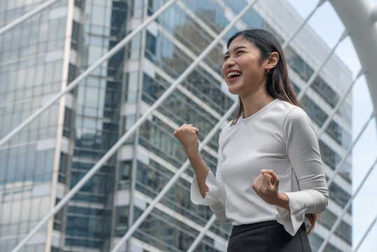 Exciting Asian woman expressing feeling good mood.