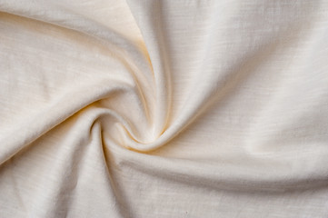 Fragment of crumpled light cotton linen fabric