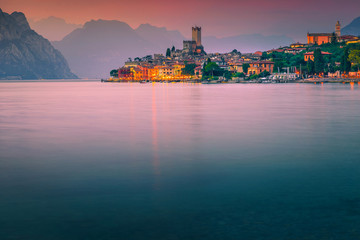 Wall Mural - Popular Malcesine tourist resort at colorful sunset, Garda lake, Italy