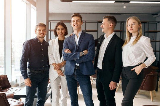 young creative business team leading with a clever boss who is standing with folded arms, close up photo. lifestyle, free time, spare time