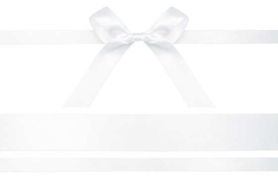 White ribbon with gift bow isolated on white. Festive bow of white shiny satin ribbon and line of ribbon