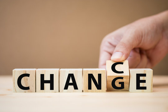 """Hand flipping wooden cubes for change wording between """"change"""" to """"chance"""".Mindset for career growth business."""