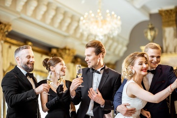 Elegant people during a celebration indoors Wall mural