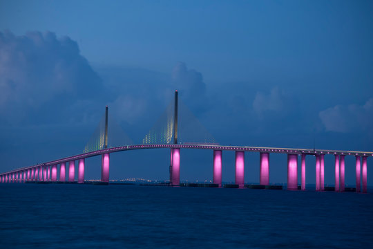 The iconic Sunshine Skyway Bridge spanning the wide mouth of beautiful Tampa Bay in central Florida lit up in pink LED lights to commemorate Breast Cancer Awareness Month.