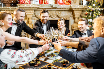 Elegantly dressed people celebrating New Year holiday indoors Wall mural