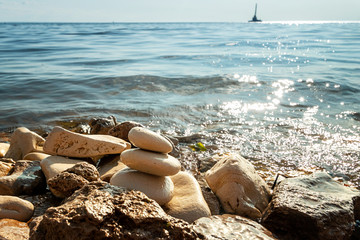 Shoreline with water and rocks, peaceful and zen-like picture Wall mural