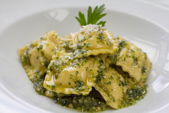 Italian ravioli stuffed with ricotta cheese and pesto
