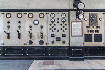 Dials and switches in the control room in old power plant. Control panel with measuring instruments