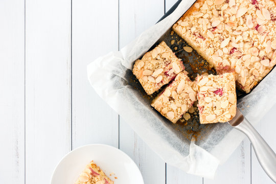 Homemade Rhubarb Crumble Cake in Baking Tray and on Plate
