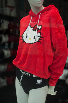 Mulhouse - France - 27 October 2019 - Closeup of Hello kitty symbol on red pullover in fashion store showroom