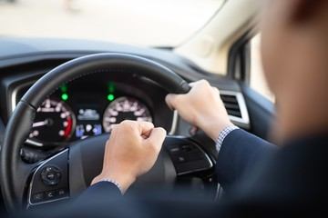 image man with a fist pump while driving in a car