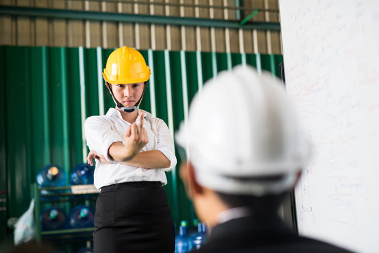Angry woman worker show middle finger to boss
