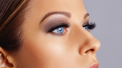 Woman eyes with long eyelashes and smokey eyes make-up. Eyelash extensions, makeup, cosmetics, beauty