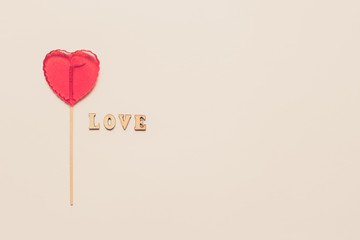 Food and drink, holidays concept. Heart shaped lollipop for love Valentines Day with white...