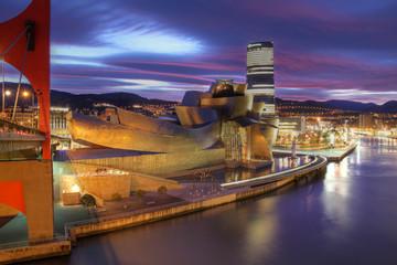 Night scene with Guggenheim Museum in Bilbao, Spain on December 15, 2011