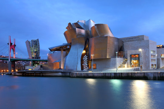 Evening scene with Guggenheim Museum, Bilbao, Spain on December 15, 2011