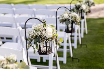 wedding aisle with hanging lanterns