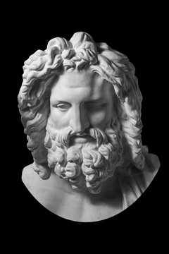 Gypsum copy of ancient statue Zeus head isolated on black background. Plaster sculpture man face.
