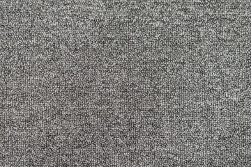 Seamless generic grey carpet background texture.