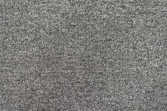 Seamless generic grey carpet background texture.