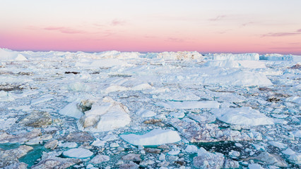 Global warming - Greenland Iceberg landscape of Ilulissat icefjord with giant icebergs. Icebergs...