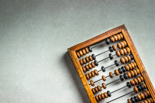 Old wooden scratched vintage decimal abacus on concrete background. Top view. Mock up. Copy space