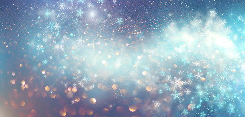 Winter Christmas and New Year glittering snow flakes swirl bokeh background, backdrop with sparkling blue stars, holiday garland, magic glowing stars, lights. Abstract Glitter Blinking sparks