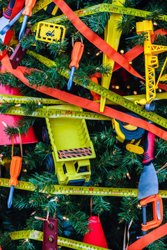 Christmas tree decorated with toy tools, truck, wrench