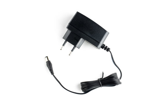 a ac dc black power adapter isolated on white background. view from above.