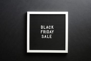 Black friday sale sign on letter board over black background
