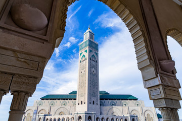 View of Hassan II mosque against blue sky - The Hassan II Mosque or Grande Mosquée Hassan II is a mosque in Casablanca, Morocco. Wall mural