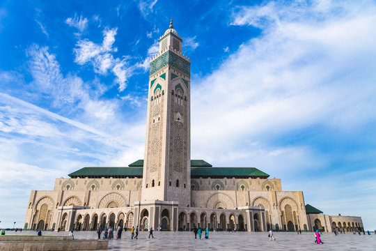 View of Hassan II mosque against blue sky - The Hassan II Mosque or Grande Mosquée Hassan II is a mosque in Casablanca, Morocco.
