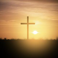 christian cross at sunset sky