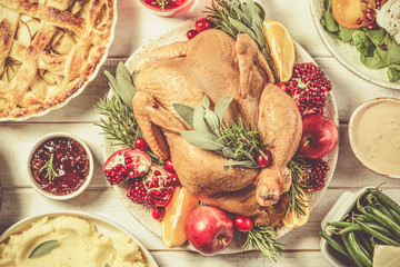 Selection of traditional thanksgiving food - turkey, mashed patatoes, green beans, apple pie on...