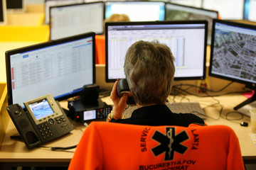 Shallow depth of field (selective focus) image with 112 emergency number operator (Romanian version of 911) having a conversation with a distress caller