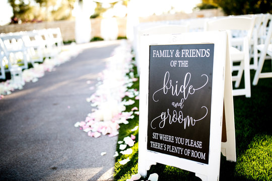 bride and groom aisle seating sign at ceremony