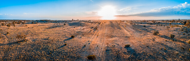 Sunrise over Australian desert - wide aerial panoramic landscape